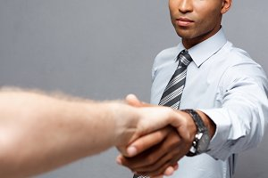 Business concept - Close-up of two confident business people shaking hands during a meeting.