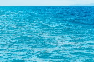 Bright Blue ocean with smooth wave background.