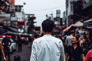 Back view of Portrait Young asian man walking on khaosan road, bangkok.