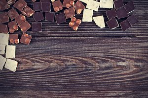 set of chocolates  on dark wood