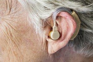 Elderly woman wearing a hearing aid