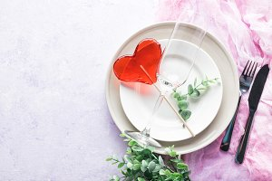 Table setting with a red candy heart