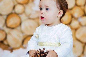 Funny little girl in white dress