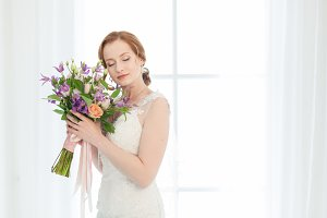 Bride with bouquet of flowers.