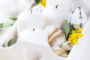 Easter table centerpiece with candle