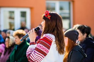 Girl with a microphone speaks