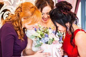 Wonderful girls with bouquet