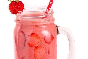 Glass of strawberry yogurt or smoothie isolated on white background