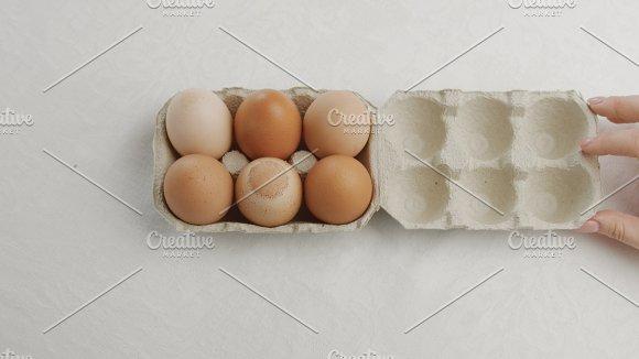 Woman's Hand Open An Eggbox