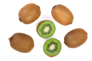 Kiwi fruit with slices isolated on white background, close-up. Top view. Flat lay pattern