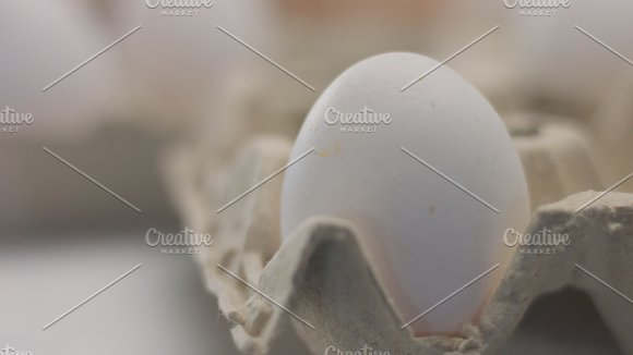 Closeup Of One White Egg In First Plane