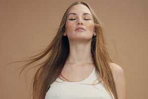 deep breathing caucasian woman with hair moved by air
