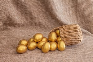 Heap of golden easter egg in wicker