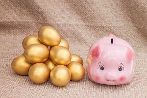 Piggy bank and golden easter egg