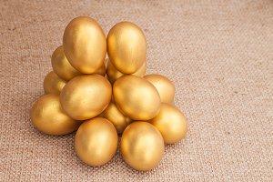 Heap of golden easter egg on brown s