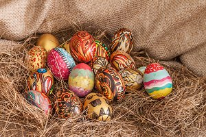 Colorful painted easter egg on hay
