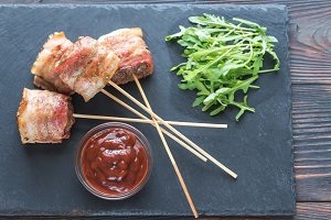 Bacon-wrapped beef skewers