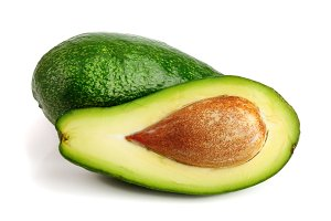 avocado and half isolated on white background close-up