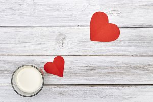 Fresh milk cup and red hearts