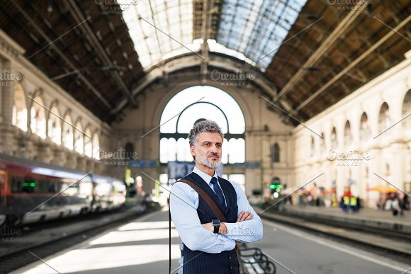 Mature Businessman On A Train Station