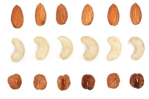 Mix nuts almonds, cashews hazelnuts isolated on white background. Top view. Flat lay
