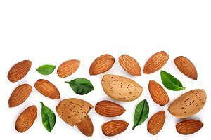 almonds with leaves isolated on white background with copy space for your text. Top view. Flat lay pattern