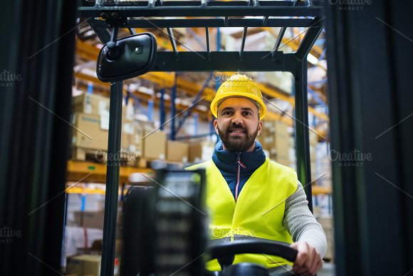 Warehouse man worker with forklift. in Graphics
