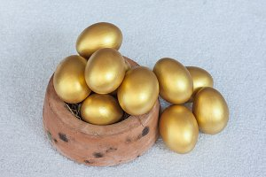 Stack of golden easter egg