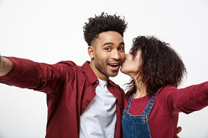 Close up attractive African American couple making a selfie with cute gesture.
