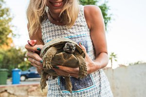 woman feeding turtle