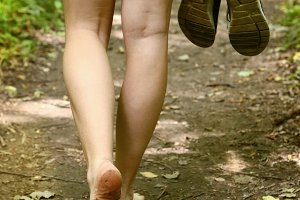 bare feet walking along forest way close up photo