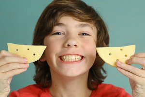 say cheese smile teenager boy with two cheese piece