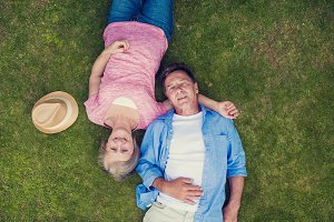 Seniors lying on the grass