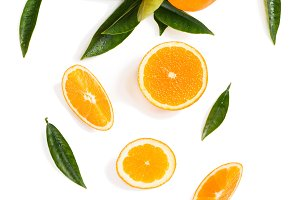 Twig with orange fruits and slices.