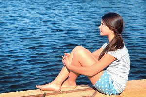 teenager beautiful girl on the country summer lake background