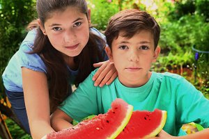 brother and sister boy and girl kids eat water melon slice