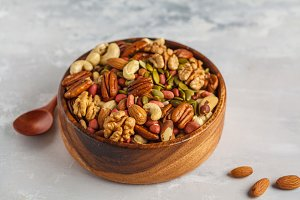 variety of nuts in a wooden bowl