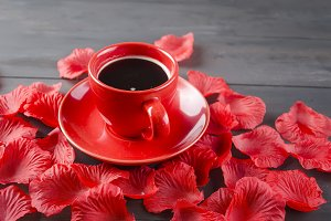 Cup of coffee and rose petals