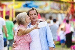 Senior couple at the fun fair