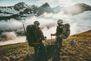 Couple backpackers enjoying mountain