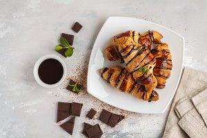 croissants with chocolate syrup