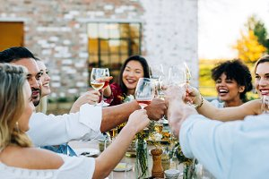 Group of people toasting wine