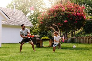 Father and son playing