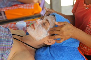 head face thai massage woman with closed eyes and massaging hands