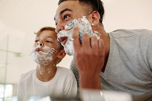 Funny father and son shaving
