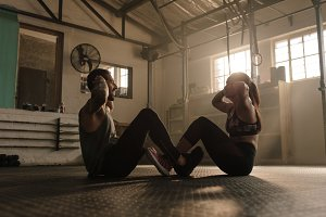 Fitness couple doing abs workout