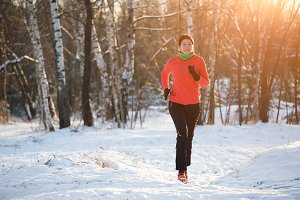 Picture of running sports girl on winter forest in morning