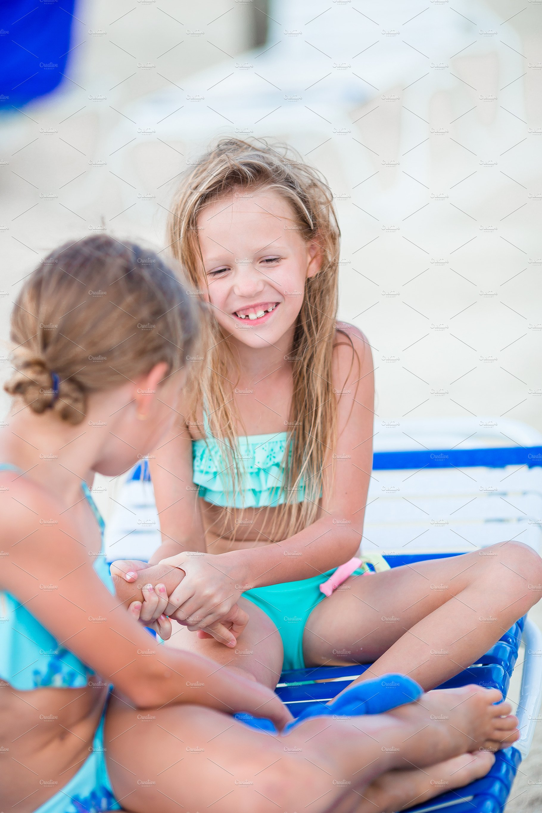 Little Girls Having Fun At Tropical Beach Playing Together