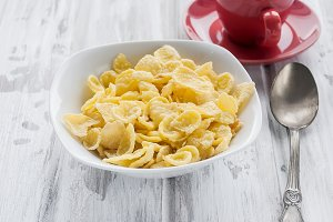 Breakfast concept with corn flakes,