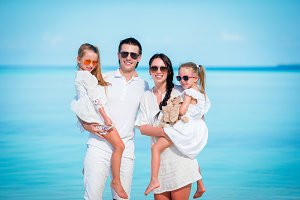 Young family on vacation on tropical beach